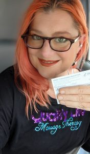 Picture of Leslie with vaccine card